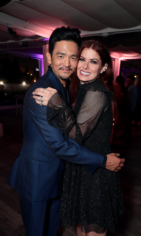 <em>The Walking Dead</em> star John Cho and Debra Messing shared a hug at the special screening of <em>SEARCHING</em>.