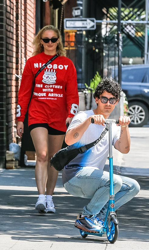 Watch out, world! Birthday boy Joe Jonas sped down the sidewalk on his scooter, followed closely by his fiancé, <em>Game of Thrones</em> star Sophie Turner.