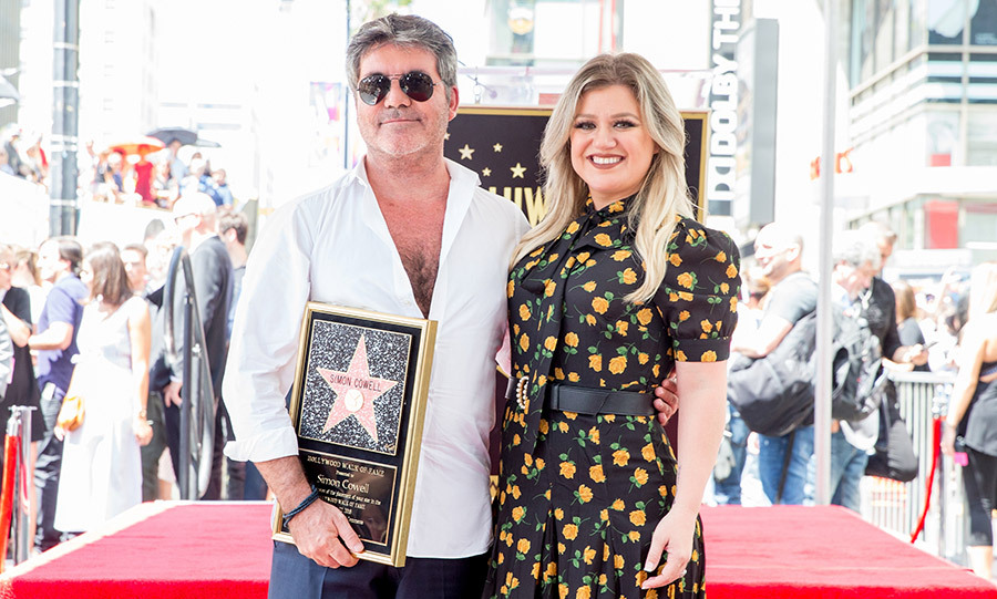 "<em>American Idol</em> winner Kelly Clarkson was on hand to help celebrate her mentor and ""best friend ever"" Simon Cowell as he got his star on the Hollywood Walk of Fame. 