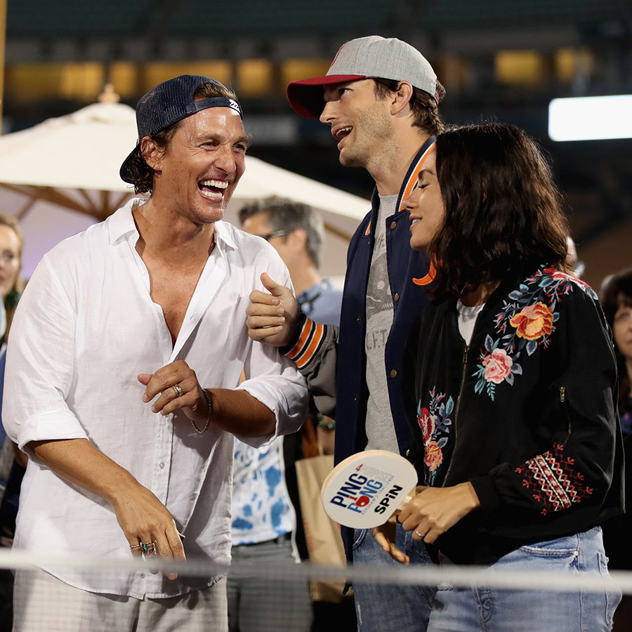 Matthew McConaughey had a blast with Ashton and Mila at Dodger Stadium, showing their competitive sides at the ping pong tables and sharing a laugh between games. 