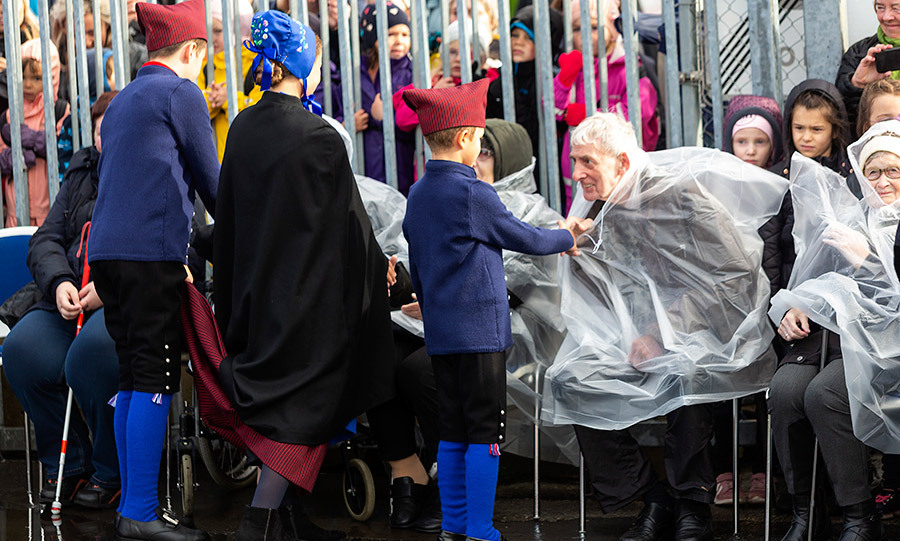 The children greeted elderly community members while in the islands' capital, Torshavn, on Aug. 23. 