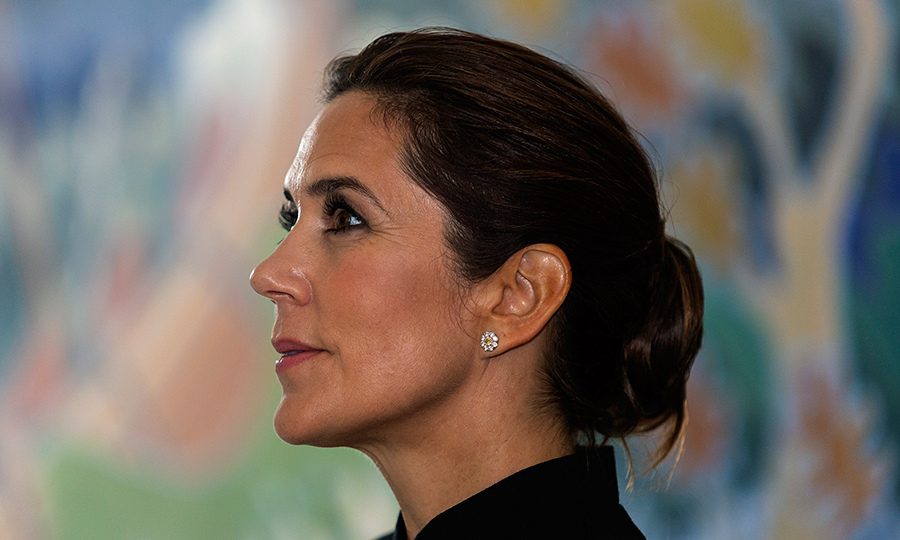 The ever-stylish Princess Mary, 46, paired her traditional clothing with a chic chignon and glittering floral earrings. The future queen paired a light smokey eye with flawless skin, some blush and a pink lip. 