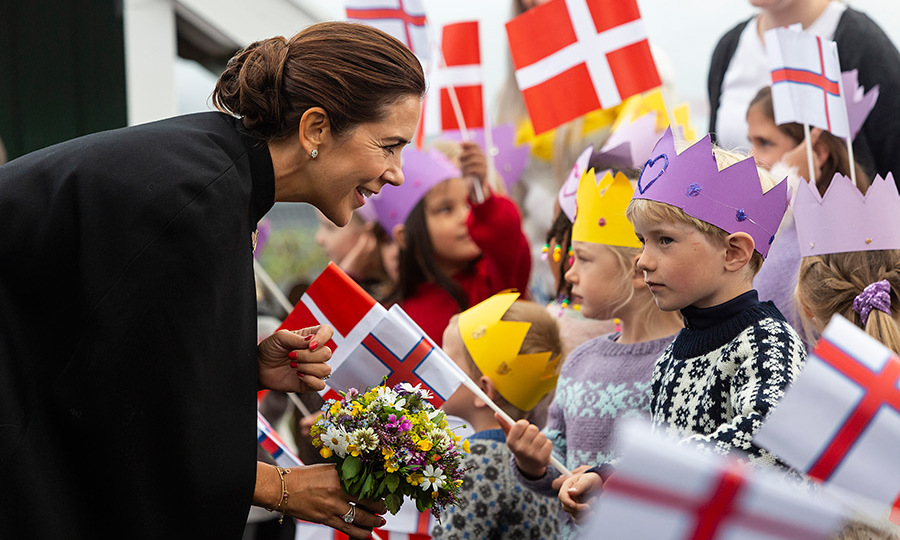 Schoolchildren were clad in crowns as they greeted the Danish royal family, who spent four days exploring the Faroe Islands, located between Iceland and Scotland.
