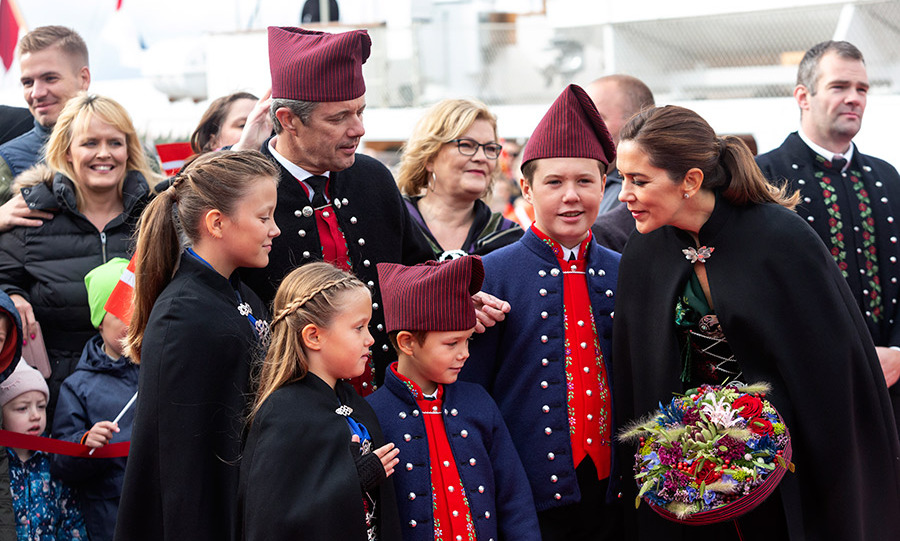 The future monarchs and their children shared a moment of calm while meeting locals in the small fishing village of Skalaroed, which is famous for salmon production, on Aug. 25. 