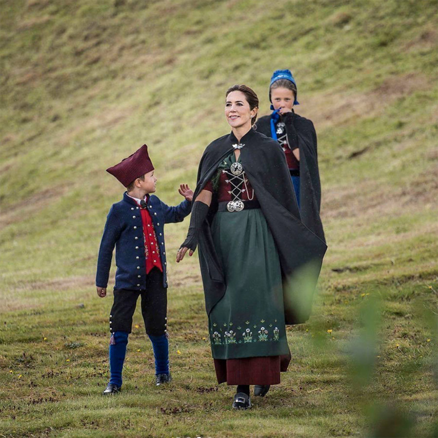 Crown Princess Mary and her children walked along the hills of Tórshavn on the first day of their tour. 