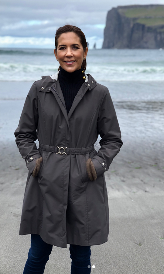 The royal kept her look chic yet casual in a belted rain coat, black turtleneck and blue jeans. 