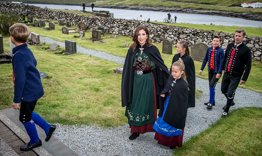 Dressed in their cultural garb, the Danish royal family arrived for a sermon at the church in Sandavagi during their official visit to the Faroe Islands.