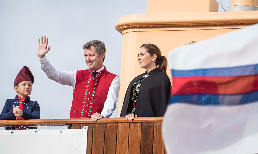 Crown Prince Frederik and Crown Princess Mary and their youngest son Prince Vincent waved while they arrived at the harbor of Bakkafrost on the Faroes Islands.