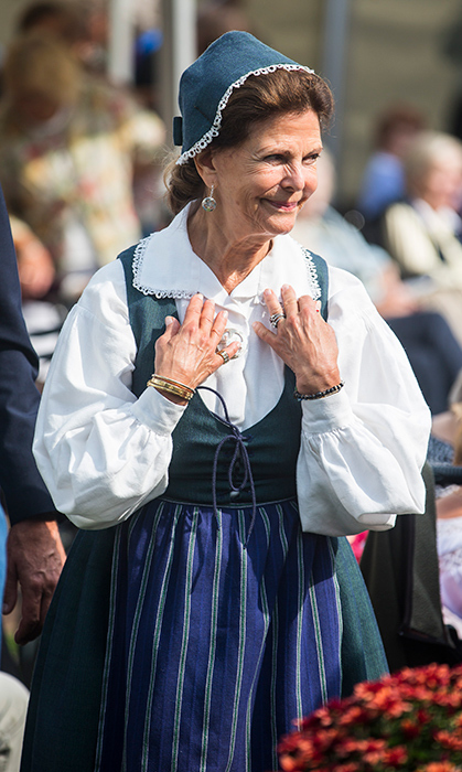Queen Silvia of Sweden was decked head to toe in cultural clothing while attending a celebration for Pensioners Day at Ekebyhov Palace Park on Aug. 27.
