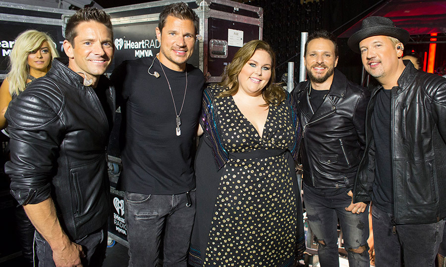 Chrissy Metz found herself in a 98 Degrees sandwich backstage, as the group showed off their megawatt smiles for the camera.