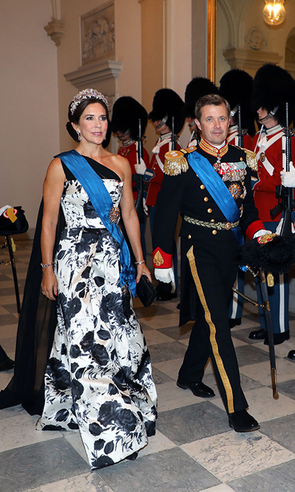 Crown Princess Mary and Crown Prince Frederik of Denmark arrived in style for a state dinner at Christiansborg Palace on Aug. 28.