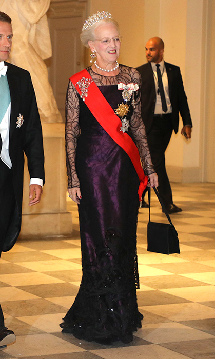 Queen Margarethe dusted off one of her most beautiful tiaras for a state dinner in Copenhagen, pairing the jewel with giant pearls and a beautiful deep purple gown.