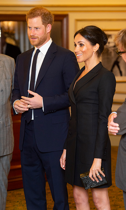 Prince Harry was beside Meghan the whole time, looking dapper as ever in a simple navy suit and slim tie.