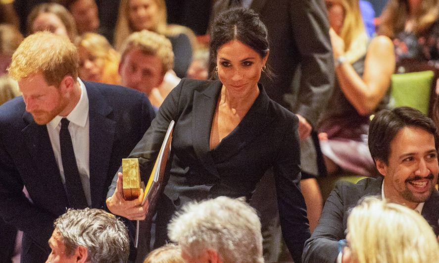 Meghan looked stunning as she sat down in the theatre.