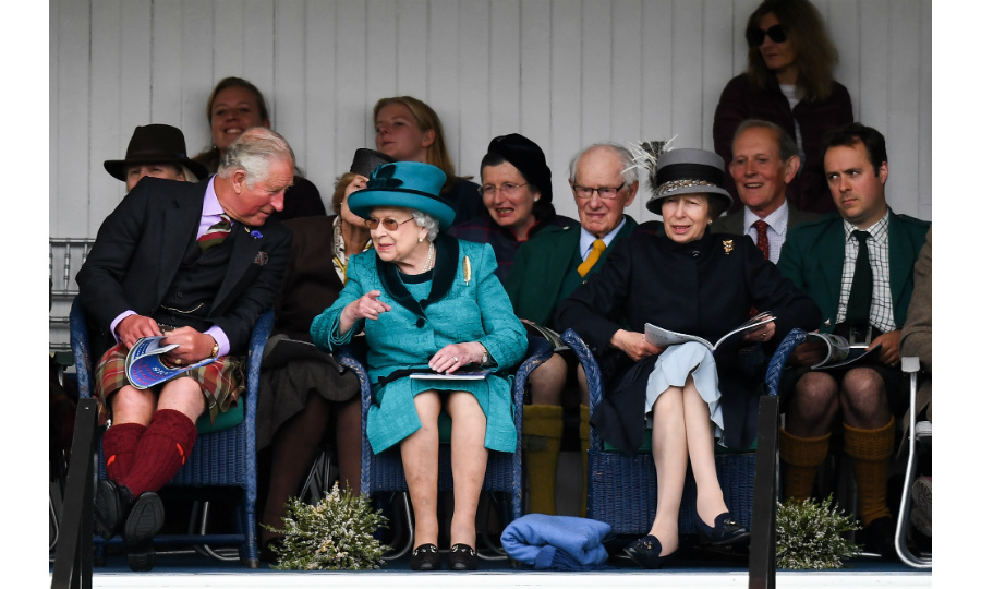The Queen looked thrilled to return to royal duties after a relaxing summer break at her Scottish retreat, Balmoral. Dressed in an eye-catching turquoise dress coat and matching hat, Her Majesty watched the festivities with her children from the royal box. 