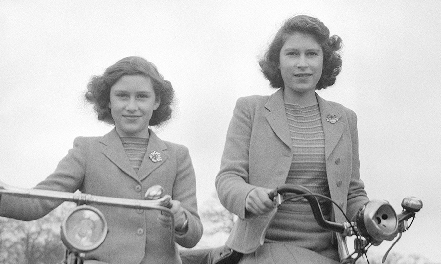 Princess Elizabeth and Princess Margaret posed on bicycles in Windsor, England in 1942.