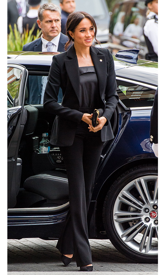 The Duchess of Sussex delighted fans in a chic black pantsuit - her third since hooking up with Prince Harry - while attending the WellChild Awards alongside her husband. She paired the Altuzzara look with a silky blouse by Czec Republic designer Deitas, black suede pumps and a black clutch with gold chain detail. Meghan gave her usual messy bun an upgrade by positioning it slightly to the side with delicately curled tendrils.