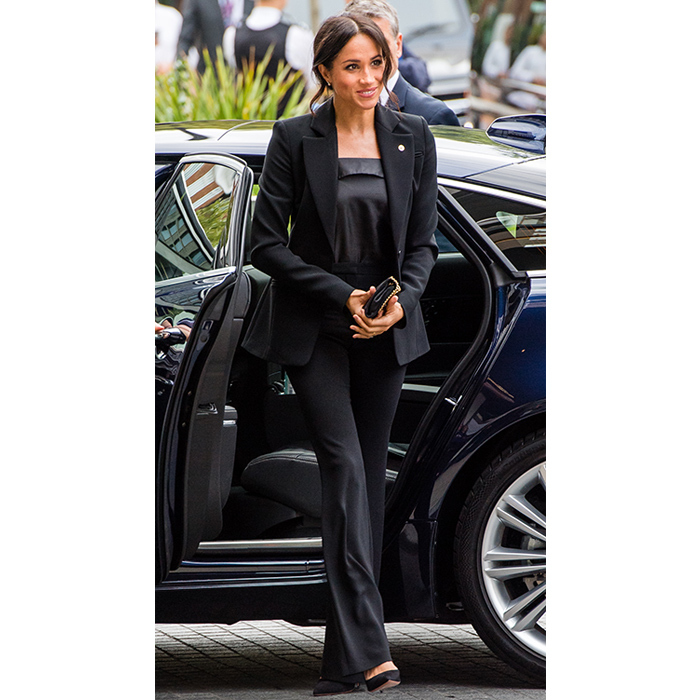 With suiting fast becoming Meghan's go-to look, the duchess donned a stunning Altuzarra two-piece suit with a black camisole by Deitas. She carried a small Stella McCartney bag and anchored the look with black pumps.