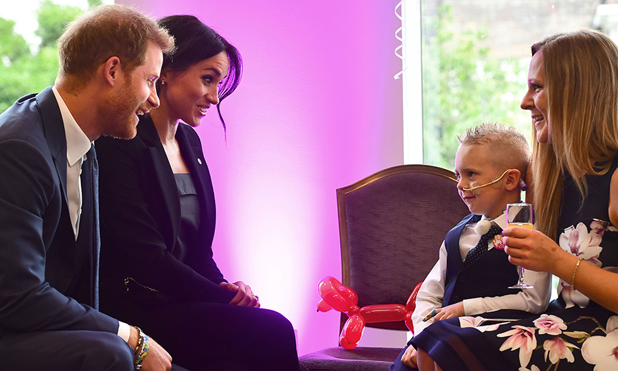The Duke and Duchess of Sussex chatted with four-year-old Mckenzie Brackley at the event, who wasn't a fan of the cameras. The couple put him at ease by saying that's one part of royal life they aren't too keen of either!