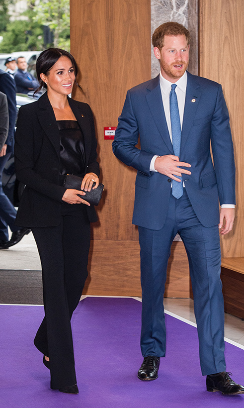 While the duchess donned a chic suit, her husband did, too! Prince Harry looked dapper as ever in a blue two-piece.