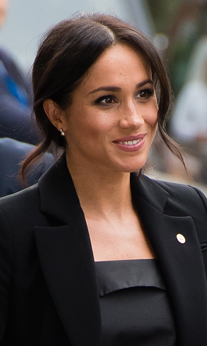 As always, Meghan showed off her natural beauty with a simple makeup look and a messy side bun.