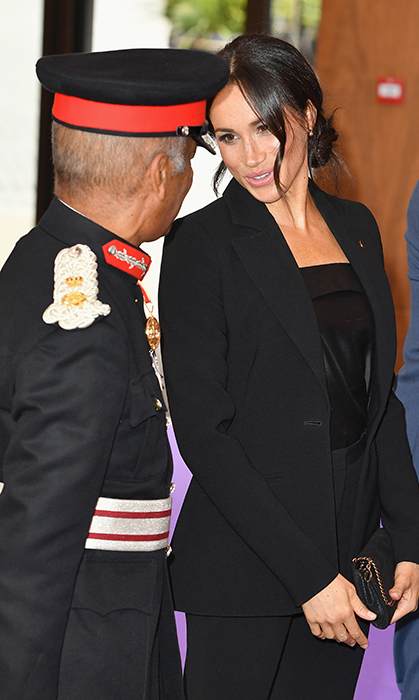In her true charm, Meghan chatted with one of the officers who was on hand to greet her.