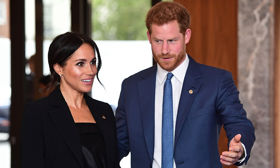 Prince Harry showed her the way, leading her through the entrance and through the lobby to meet with WellChild officials.