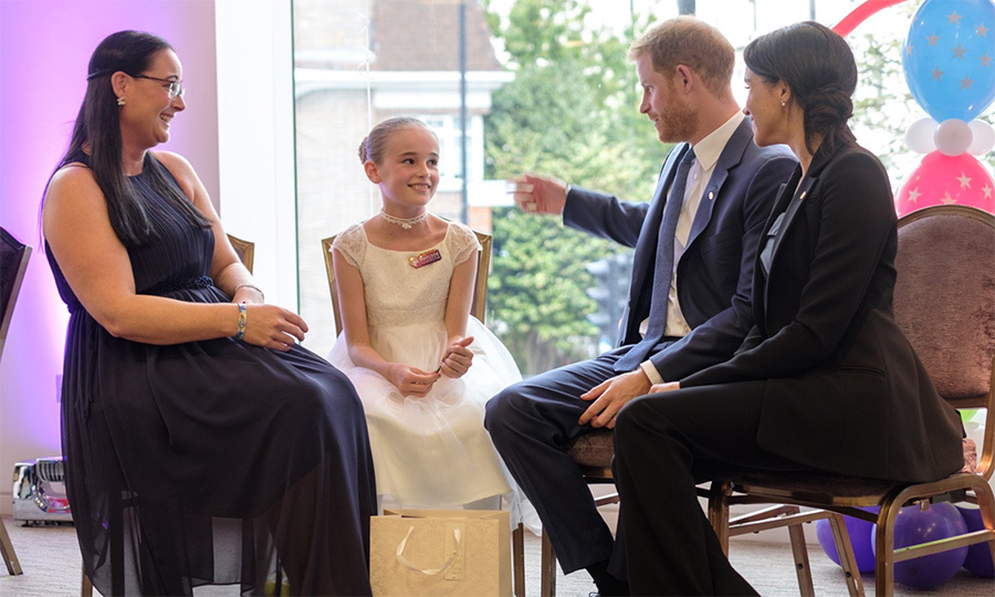 Meghan and Harry met with 10-year-old Scarlett, who helps care for her older sister Freya, who is severely disabled.