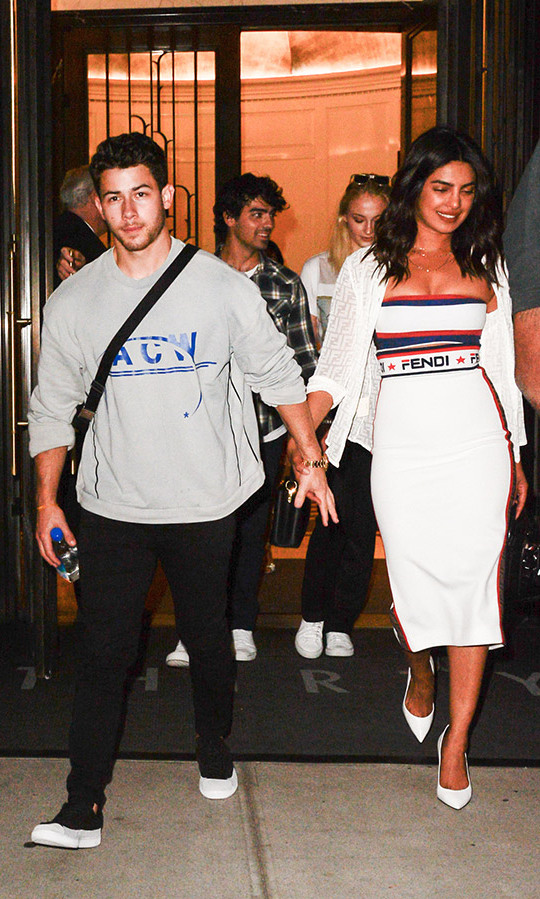 Double date night! Newly engaged Nick Jonas and Priyanka Chopra headed to the US Open with his brother Joe Jonas and his fiancee Sophie Turner. Priyanka looked stunning in her tennis whites, head-to-toe Fendi. 