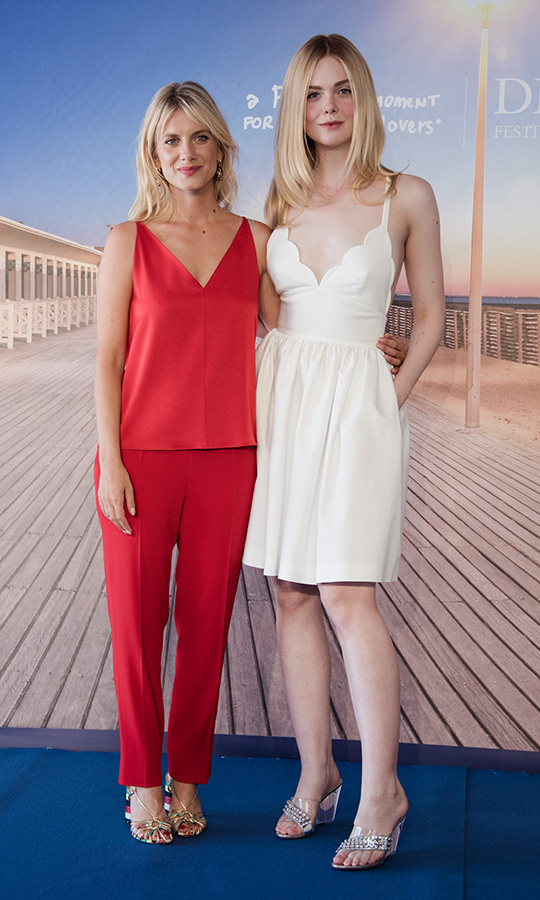 Melanie Laurent and Elle Fanning posed on the blue carpet at the Deauville US Film Festival in France, where they were presenting Melanie's English-language directorial debut, <em>Galveston</em>.