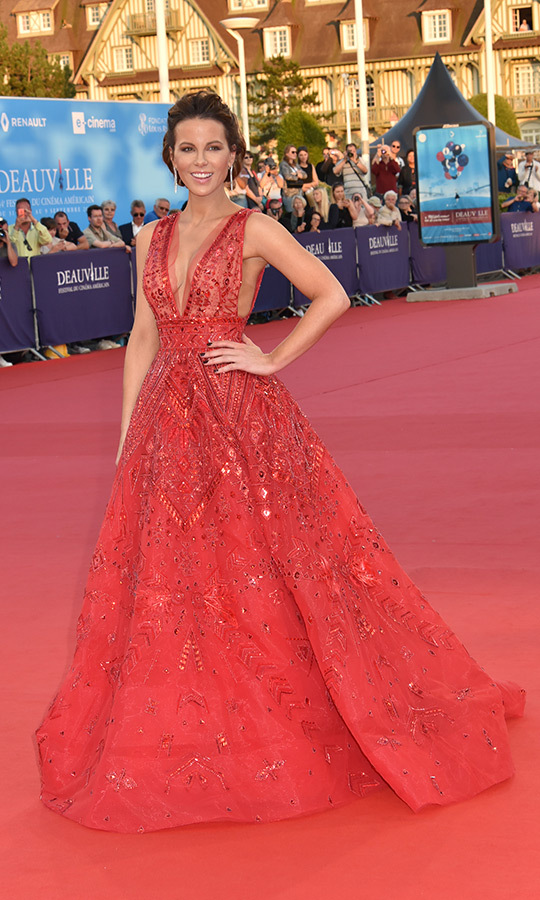 Lady in red! The actress made a dazzling appearance on the red carpet in Deauville on Sept. 2 at the <em>Love & Friendship</em> premiere.