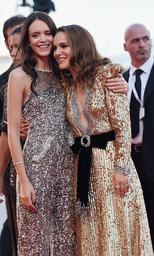 Gucci-clad Natalie also snuggled up to co-star Stacy Martin, who wore a fashion-forward Chanel jumpsuit at the Venice Film Festival premiere.