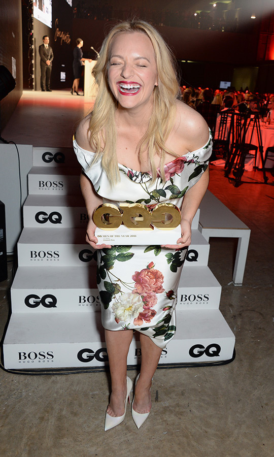 <em>The Handmaid's Tale</em> star Elisabeth Moss couldn't contain her excitement after nabbing the nod for Television Actress of the Year at the GQ Men of the Year Awards. The celebrated actress wore a gorgeous floral dress with white pumps, a red lip and her blonde locks in loose waves.