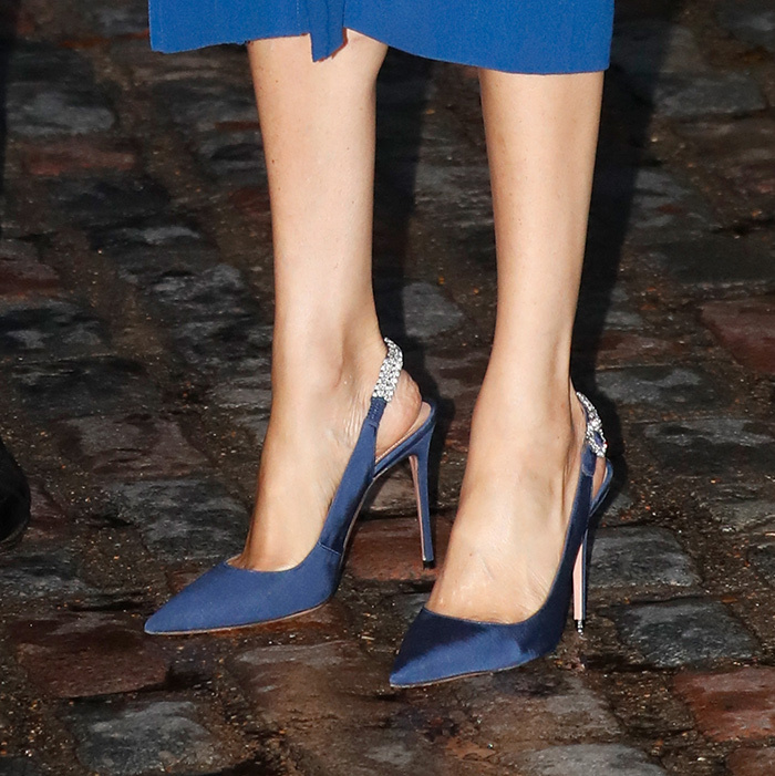 Her Aquazzura heel collection is certainly growing! These slingback navy pumps by the luxury brand are perfectly polished.