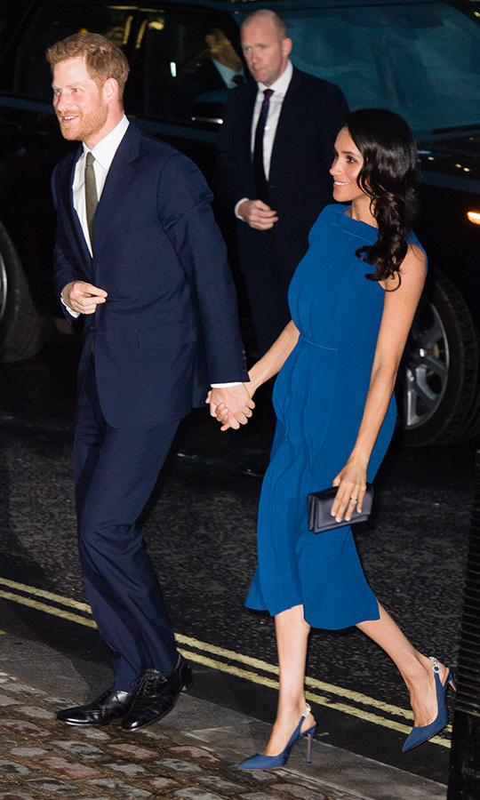 The Duke and Duchess of Sussex arrived at the 100 Days to Peace gala with their hands firmly clasped! If that wasn't cute enough, the couple looked stylish as ever in coordinated blue ensembles.