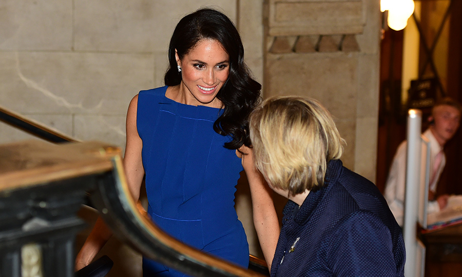 The Duchess of Sussex showed off her megawatt smile while chatting with one of the officials.