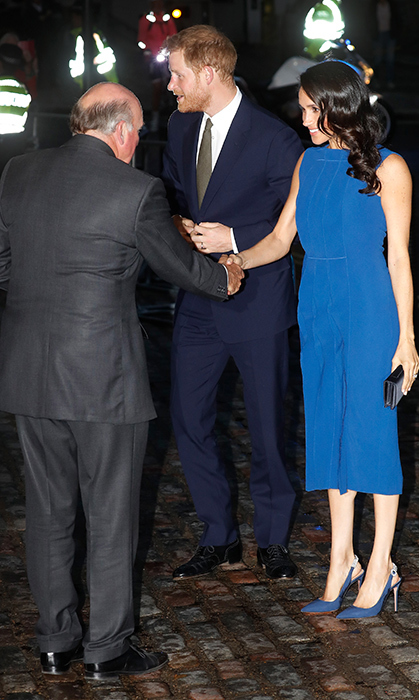Ever the gracious guests, the couple spent time chatting with event organizers outside the venue before heading inside.