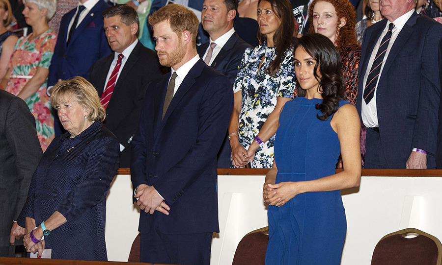 The Duke and Duchess of Sussex made their entrance and stood for the national anthem. 