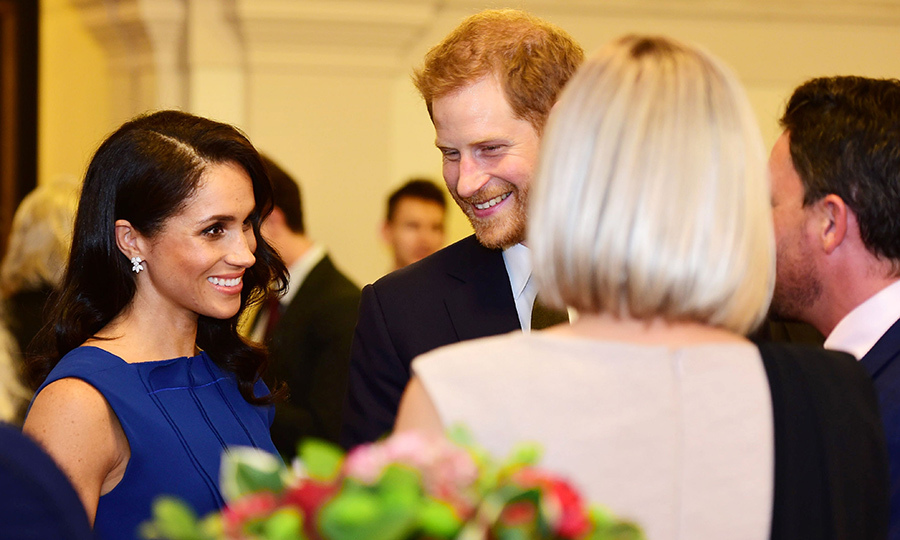 Meghan's glamorous Hollywood hairstyle showed off her glittering Birks Snowflake earring, a dazzling choice for the evening gala. 