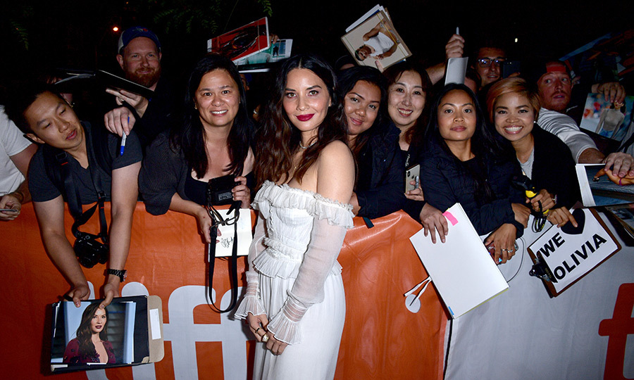 Olivia Munn dazzled in a boho chic Jonathan Simkhai dress for the Midnight Madness premiere of <em>The Predator</em>. The star graciously took time to greet her fans outside of the Ryerson Theatre.