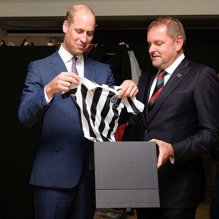 Possibly Britain's biggest soccer fan, Prince William was given a Newcastle United football shirt for his son Prince George. How cute!