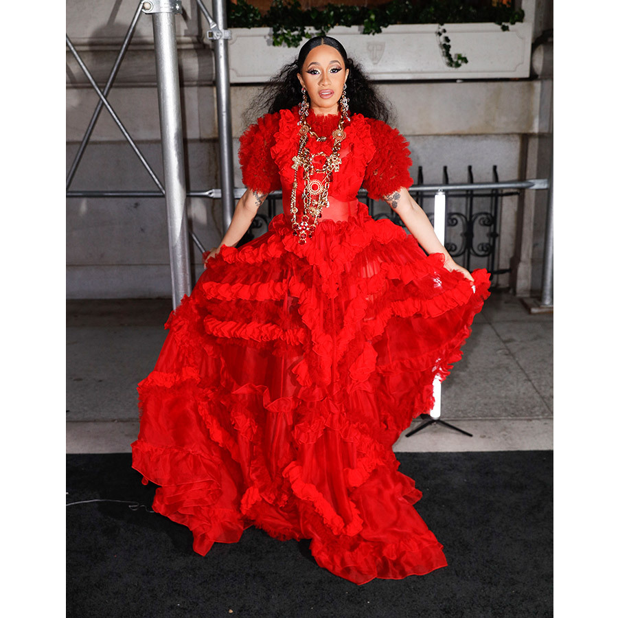 Cardi B was red hot in a voluminous gown at the BAZAAR Icons fete, though her Cinderella moment included a lost show, which she reportedly threw at Nicki Minaj during the party. 