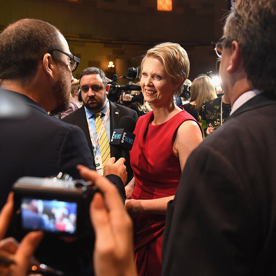 New York governor candidate and former <em>Sex and the City</em> star Cynthia Nixon looked at ease in front of the cameras at Christian Siriano's New York Fashion Week show on Sept. 8.