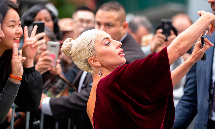 From mother monster to movie star! Lady Gaga snapped a selfie with fans outside her TIFF press conference for <em>A Star Is Born</em>.