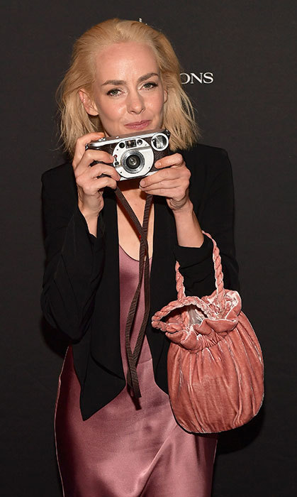 "Say ""cheese""! Jena Malone snapped a photo at InStyle's TIFF celebration party on Sept. 7.