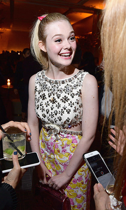 Elle Fanning was happy as a clam at InStyle's after-party, and had a cheerful dress on to match.