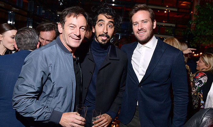 Dev Patel got a little goofy for a photo with Jason Isaacs and Armie Hammer.