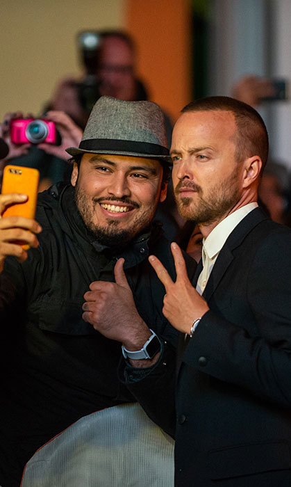 Peace! Aaron Paul paused for a fan photo at the premier of his film, <em>American Woman</em>.