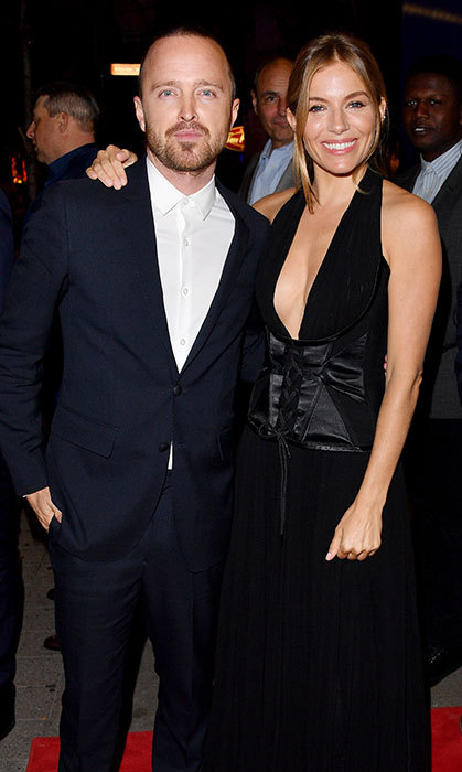 <em>American Woman</em> co-stars Aaron Paul and Sienna Miller stopped for a quick snap together.