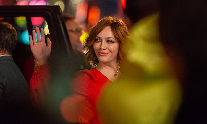 Christina Hendricks looked so beautiful as she waved at fans outside of the Princess of Wales Theatre.